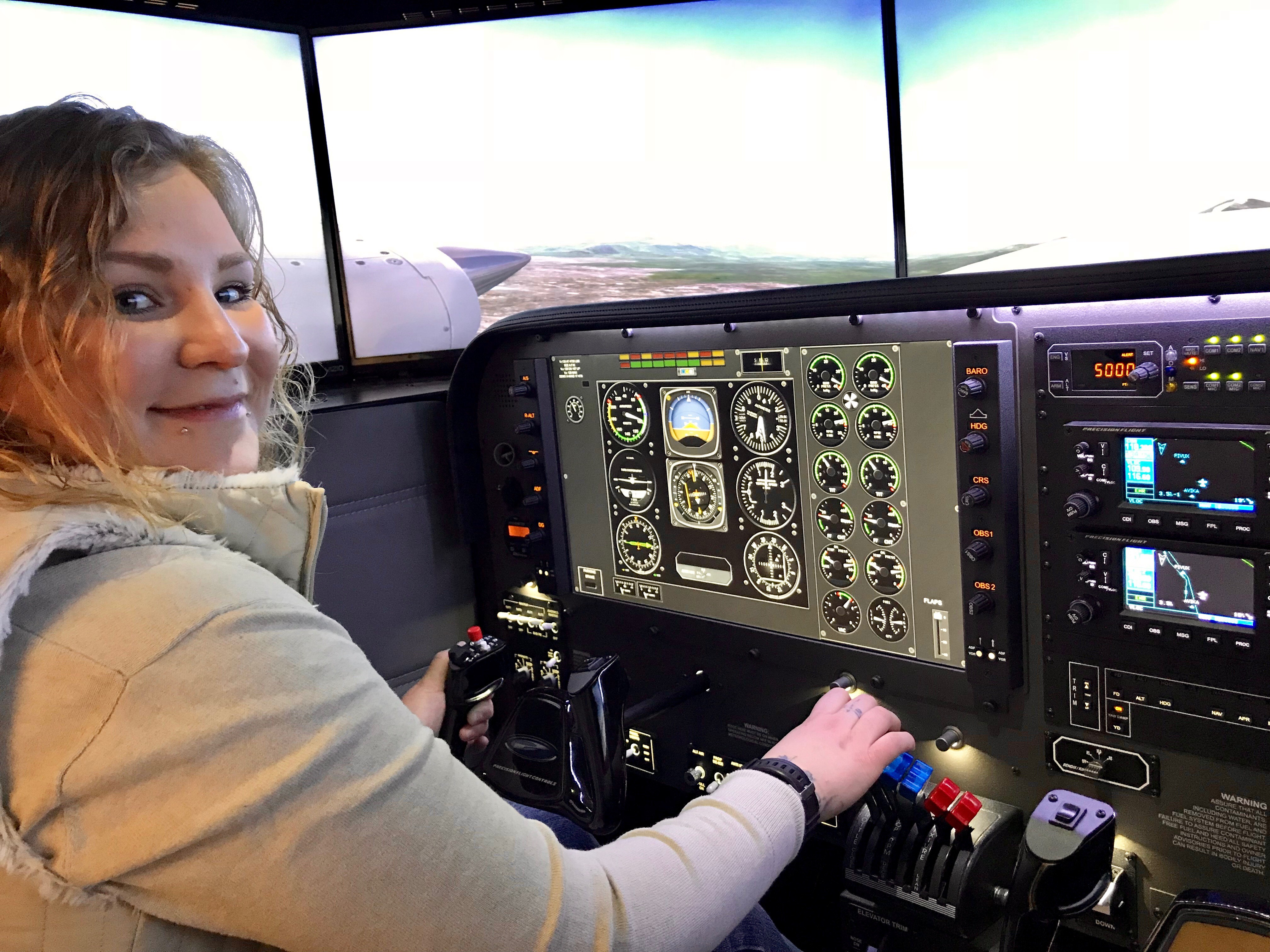 Helina TenHoeve, Aviation Management Diploma student tests out the new flight similator