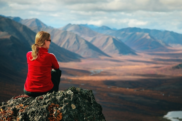 person looking out on a mountain range