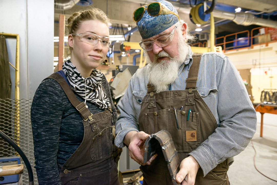 student with welding instructor