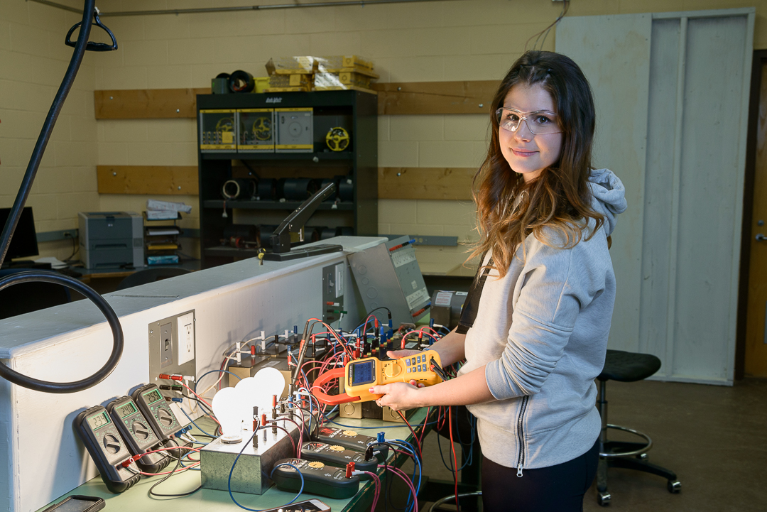 student with electrical equipment