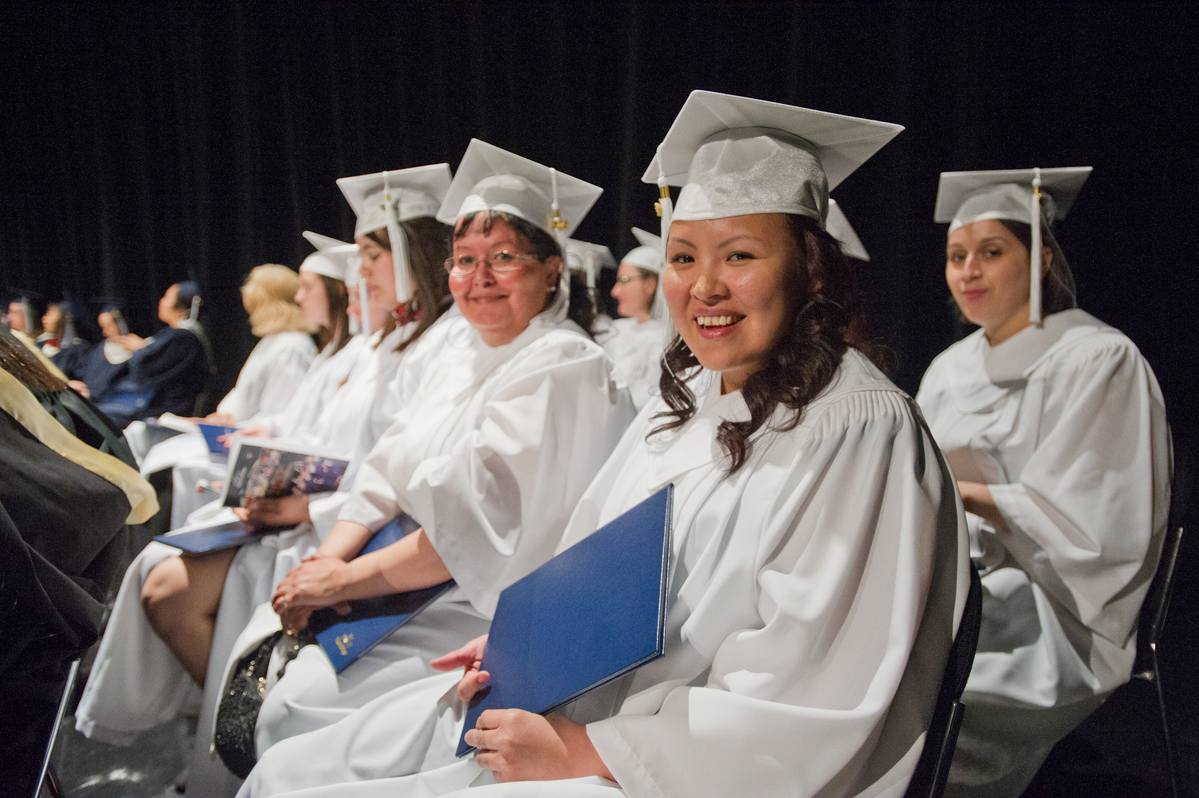 Nursing grads in white gown
