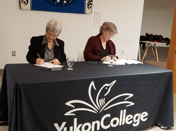 Dr. Janet Welch and Jeanne Beaudoin sign the MOU document