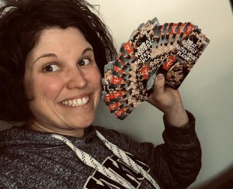 woman holds gift cards