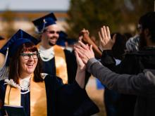 graduates receive high fives